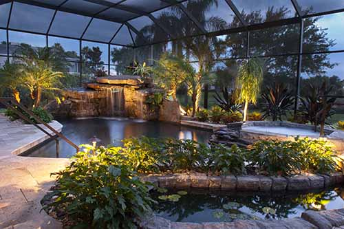 swimming pool remodel with natural stone grotto and stone waterfalls in Sarasota, Florida
